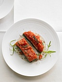 Salmon trout with tomato ragout on spinach