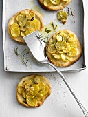 Potato pizzette with rosemary and garlic