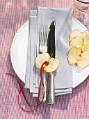 Place-setting with apple decoration
