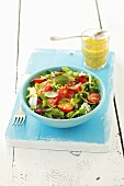 Salad leaves with cherry tomatoes and honey & mustard dressing