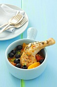 Chicken leg with tomatoes, olives, oranges and saffron
