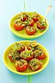 Stuffed cherry tomatoes with rocket pesto