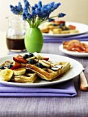 Wholemeal waffles with bananas, berries and maple syrup