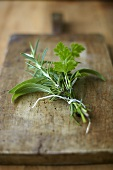 A bouquet of herbs on a wooden board
