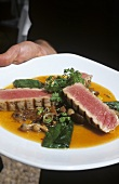 Grilled tuna in ginger Chardonnay sauce with mushrooms