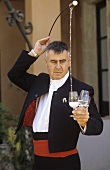 Pouring sherry into glasses from a venencia, Jerez, Spain