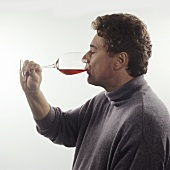 Tasting wine: taking a sip