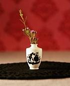 Flowering rosemary in vase