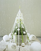 Winter flower arrangement with baubles