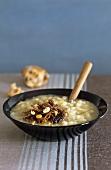 Jerusalem artichoke soup with duck confit and hazelnuts