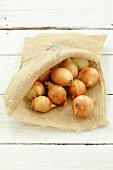 Small onions in a hessian sack