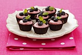 Chocolate bowls with raspberry mousse and blueberries
