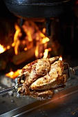 A grilled chicken on a spit