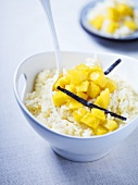 Rice pudding with mango and vanilla pods