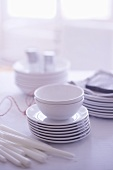 White crockery and candles on a table