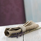 A napkin with a napkin ring and lavender flowers from Provence