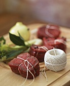 Beef medallions tied with kitchen twine