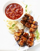 Duck kebabs with pineapple sauce