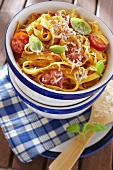 Tagliatelle with cherry tomatoes, basil and grated cheese