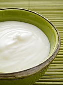 Natural yogurt in a green bowl