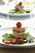 Salmon towers with a tomato and spinach salad