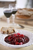 Beetroot stew, bread and red wine
