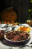 Pumpkin pie with pecan nuts for Halloween