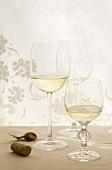 White wine glasses and corks