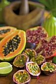 Fresh exotic fruit (purple granadillas, papaya, pomegranate, limes)