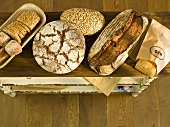 Various organic bread on a wooden surface
