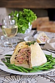 Rabbit and mushroom pie, sliced, with green beans