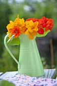 Nasturtiums in a green metal vase