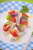 Trout fillets with tomatoes and red onions