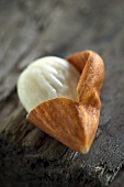 A half-shelled almond