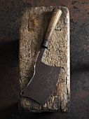 An old meat cleaver on a piece of wood