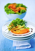 Salad with pumpkin slices and mini corn cobs