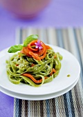 Green tagliatelle with salmon strips and pesto
