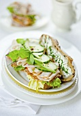 Bread topped with turkey spread, cucumber and lettuce