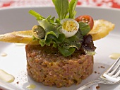 Beef tartar with sardines and quail's eggs