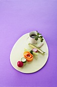 Raw vegetables on skewer with soy sauce