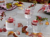 Autumnal table decoration with floating candles