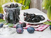 Prunes on plate and in jar