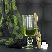 Glass of absinthe, spoon and sugar cubes