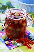 Gooseberry and redcurrant compote in preserving jar