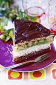 Piece of gooseberry cake with chocolate icing