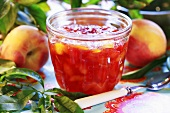 Peach jelly in jam jar