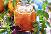Peach and orange jam in screw-top jar