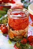 Pickled tomato salad in preserving jar