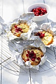 Goat's cheese with cranberries baked in aluminium foil