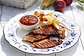 Barbecued pork chops with tomato sauce